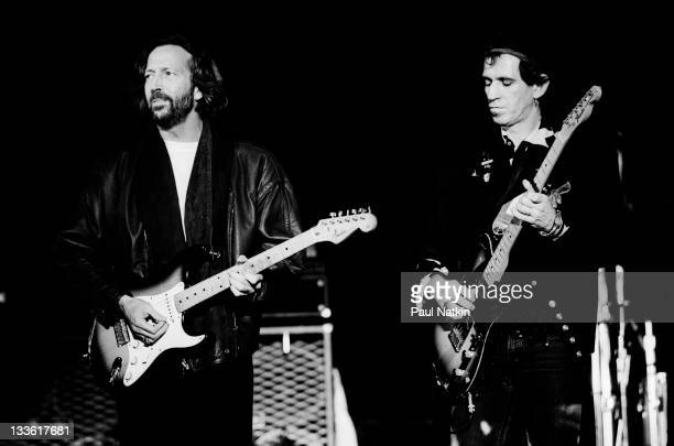 British musician Eric Clapton performs with Keith Richards of the Rolling Stones on stage during the band's 'Steel Wheels' tour late 1989