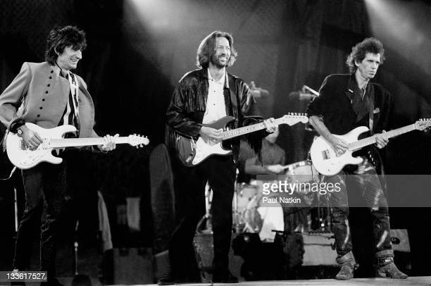 British musician Eric Clapton performs with Ron Wood and Keith Richards of the Rolling Stones on stage during the band's 'Steel Wheels' tour late 1989
