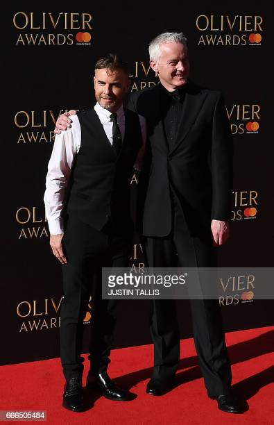 British musician Gary Barlow and English screenwriter Tim Frith pose on the red carpet upon arrival to attend the 2017 Laurence Olivier Awards in...