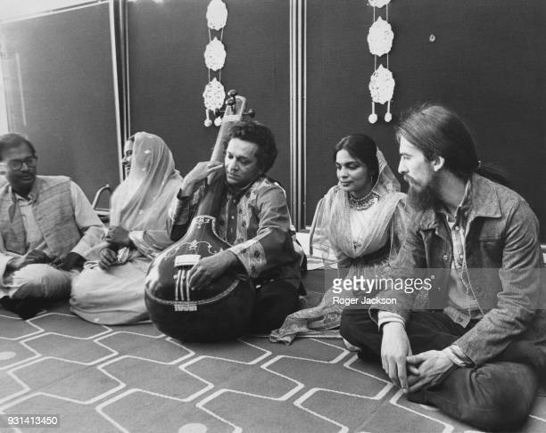 British musician George Harrison of the Beatles with a company of seven top Indian instrumentalists singers and dancers including Ravi Shankar at a...