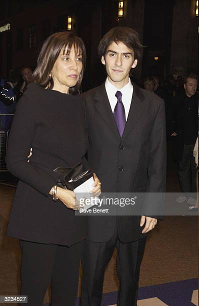 British musician George Harrison's wife Olivia and son Dhani arrive at the screening of the Royal Albert Hall Concert in memory of the late George...