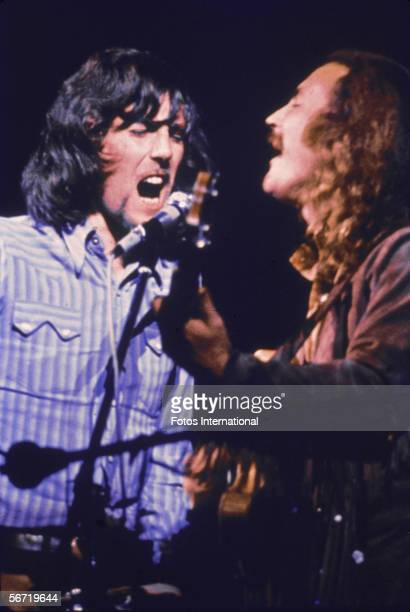 British musician Graham Nash and American musician David Crosby of the group Crosby Stills Nash performs on stage at the Woodstock Music and Art...