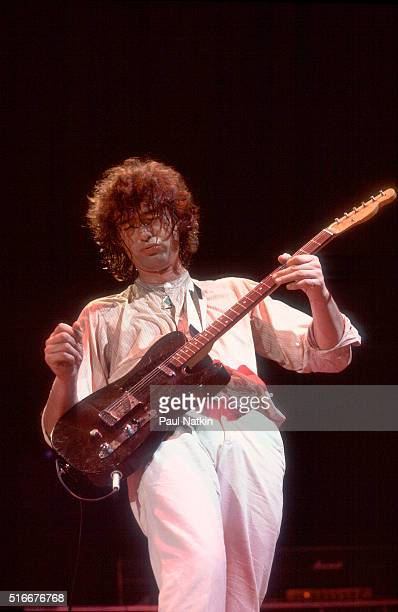 British musician Jimmy Page, of rock group the Firm, plays guitar as he performs onstage at the Milwaukee Arena, Milwaukee, Wisconsin, March 7, 1985.