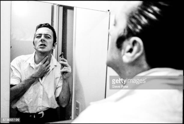 British musician Joe Strummer formerly lead singer of the Clash shaving with the help of a mirror in Alabama USA 1987
