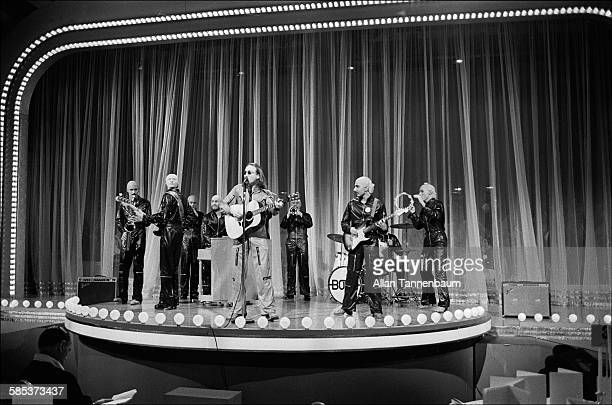 British musician John Lennon and his backing band BOMF perform onstage at the Hilton Hotel's Grand Ballroom New York New York April 18 1975 The...