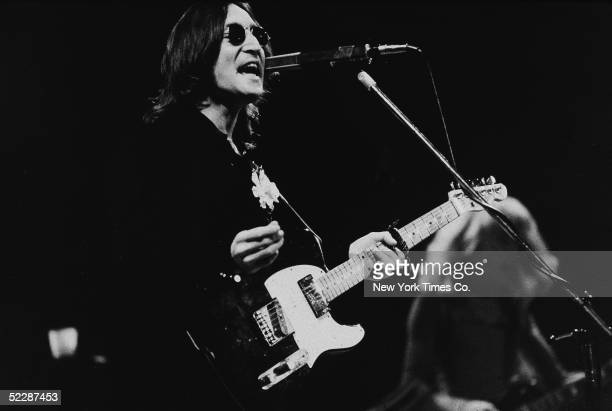 British musician John Lennon performs onstage in Madison Square Garden, New York, New York, November 28, 1974.
