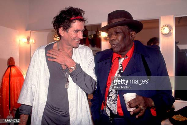 British musician Keith Richards backstage American musician John Lee Hooker on the former's 'Main Offender' tour early 1993