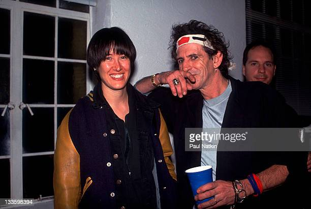 British musician Keith Richards backstage American musician Michelle Shocked on the former's 'Main Offender' tour early 1993