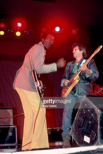 British musician Keith Richards performs with American musician Chuck Berry during the Chicago Blues Festival at the Petrillo Bandshell Chicago...
