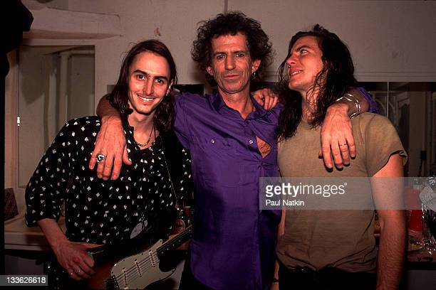 British musician Keith Richards poses backstage with American musicians Mike McCready and Eddie Vedder of the band Pearl Jam at the Academy New York...