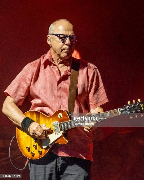 British musician Mark Knopfler OBE plays guitar as he performs on stage at Arena Leipzig Leipzig Germany July 5 2019