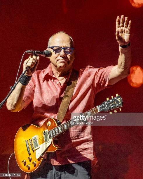 British musician Mark Knopfler OBE waves from the stage as he performs at Arena Leipzig Leipzig Germany July 5 2019