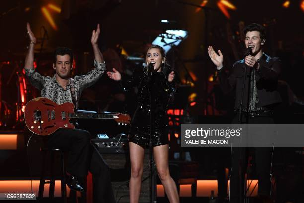 TOPSHOT British musician Mark Ronson US singer Miley Cyrus and Canadian singersongwriter Shawn Mendes perform onstage at the 2019 MusiCares Person Of...