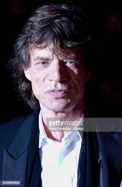 British musician Mick Jagger arrives for the premiere of Charles Shyer's movie Alfie at the Empire Leicester Square in London