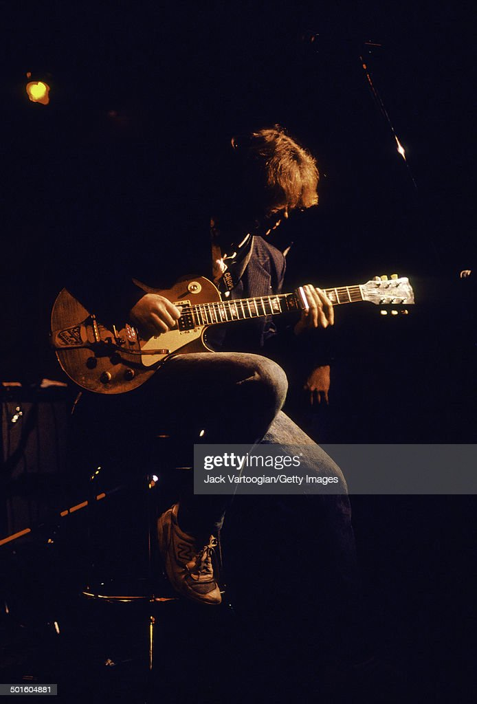 British musician Mick Taylor plays guitar onstage during the Mississippi Delta Blues Project Benefit concert at Delta 88, New York, New York, February 2, 1990.