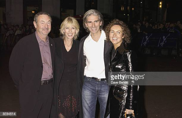 British musician Nick Mason and wife and British Formula One driver Damon Hill and wife arrive at the screening of the Royal Albert Hall Concert in...