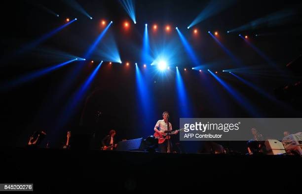 British musician Noel Gallagher with his band Noel Gallagher's High Flying Birds performs during the 'We Are Manchester' charity concert at the...