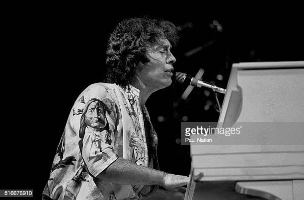 British musician Paul Rodgers, of rock group the Firm, plays piano as he performs onstage at the Milwaukee Arena, Milwaukee, Wisconsin, March 7, 1985.