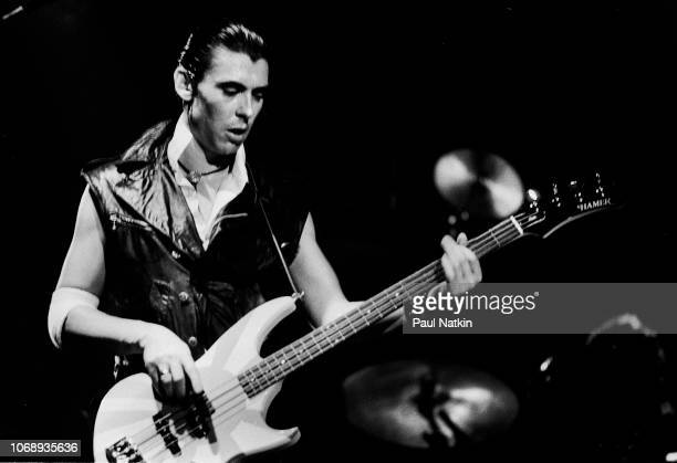 British musician Pete Farndon , of the group Pretenders, plays bass guitar as he performs at the Aragon Ballroom in Chicago, Illinois, August 22,...