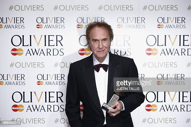 British musician Ray Davies poses with the award for outstanding achievement in music for his work on 'Sunny Afternoon' during the Lawrence Olivier...