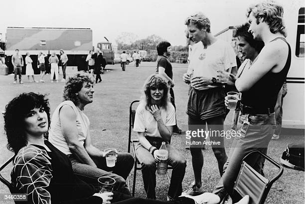 British musician Robert Plant visits members of the rock group Heart after their performance in Milton Keynes England circa 1980s Ann Wilson Robert...