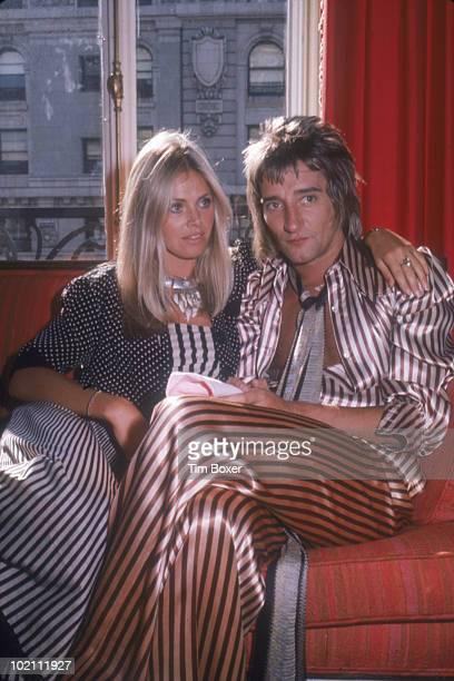 British musician Rod Stewart and his girlfriend, Swedish actress Britt Ekland, sits on a sofa in a hotel room while on a promotional tour in support...
