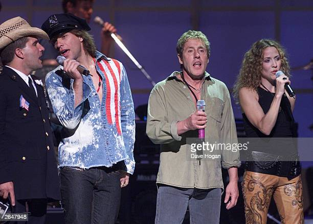 British musician Roger Daltrey and American musicians Jon Bon Jovi and Sheryl Crow perform on stage at the concert for New York City to benefit the...