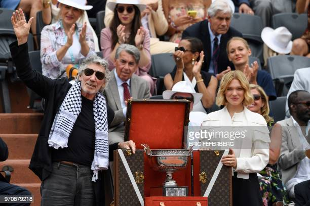 British musician Roger Waters wearing a traditional Palestinian keffiyeh scarf waves as he and French actress Lea Seydoux show the Mousquetaires Cup...