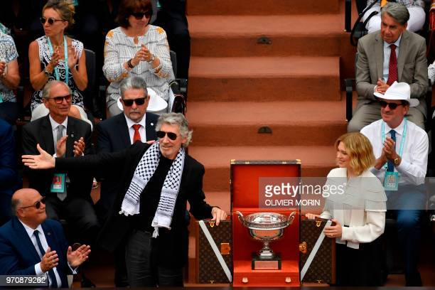British musician Roger Waters wearing a traditional Palestinian keffiyeh scarf gestures as he and French actress Lea Seydoux show the Mousquetaires...