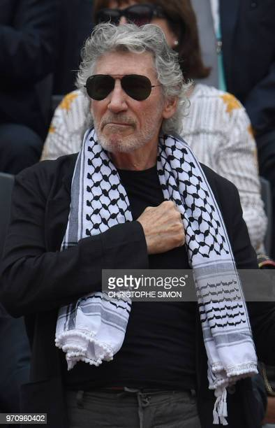 British musician Roger Waters wearing a traditional Palestinian keffiyeh scarf gestures as he stands next to the Mousquetaires Cup ahead of the men's...