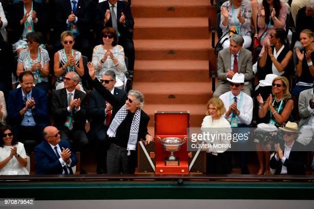 British musician Roger Waters wearing a traditional Palestinian keffiyeh scarf waves to the crowd as he and French actress Lea Seydoux show the...