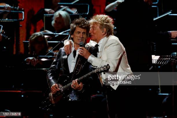 British musician Ronnie Wood and British singer Rod Stewart perform during the BRIT Awards 2020 ceremony and live show in London on February 18,...