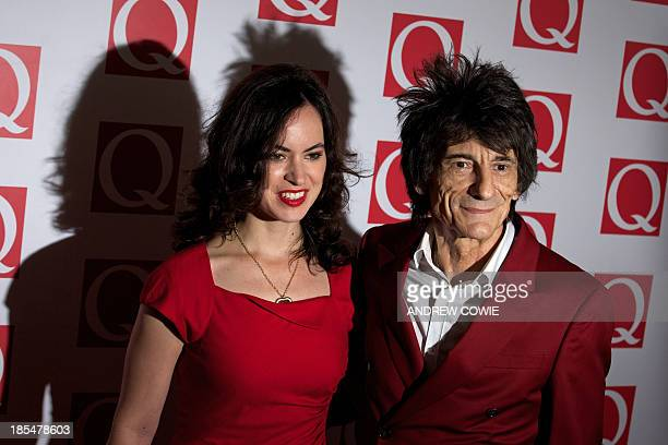 British musician Ronnie Wood and his wife Sally Wood attend The Q Awards 2013 in central London on October 21 2013 AFP PHOTO/ANDREW COWIE