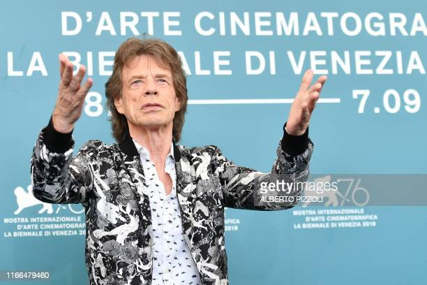 """British musician, singer and actor Mick Jagger poses during a photocall for the film """"The Burnt Orange Heresy"""" presented out of competition on..."""