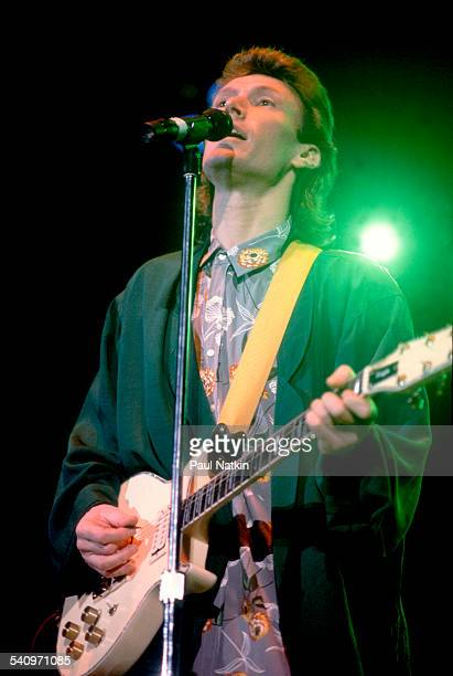 British musician Steve Winwood plays guitar as he performs onstage Chicago Illinois August 25 1986