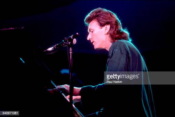 British musician Steve Winwood plays keyboards as he performs onstage Chicago Illinois August 25 1986