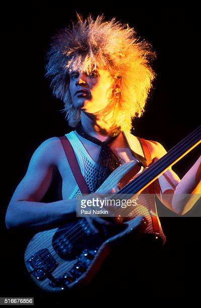 British musician Tony Franklin, of rock group the Firm, plays bass guitar as he performs onstage at the Milwaukee Arena, Milwaukee, Wisconsin, March...