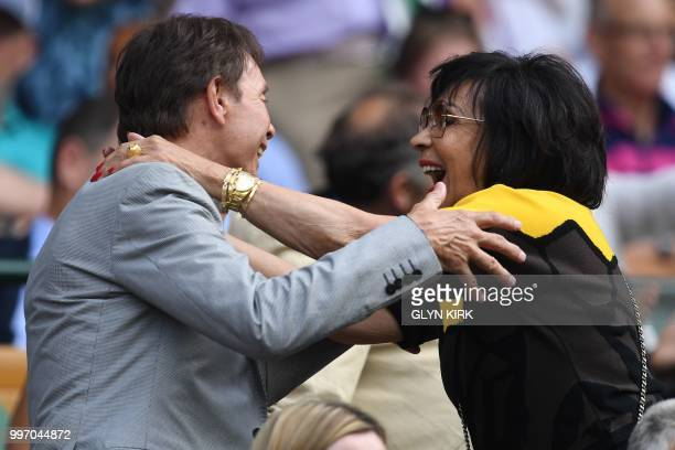 British musicians Cliff Richard and Shirley Bassey embrace on centre court before watching US player Serena Williams play Germany's Julia Goerges...
