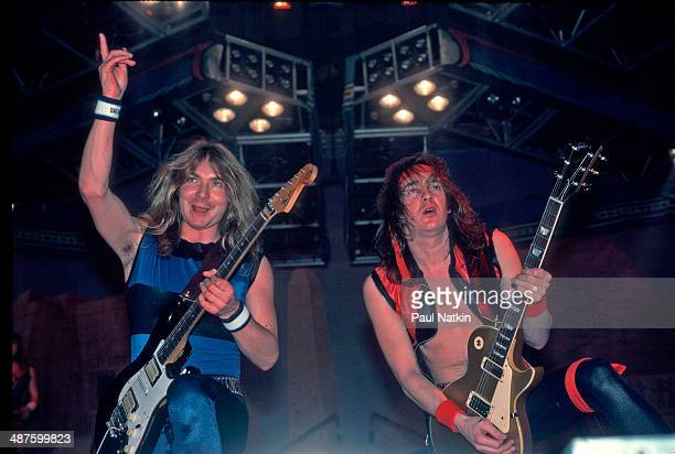 British musicians Dave Murray and Adrian Smith guitarists for the band Iron Maiden perform onstage at the Rosemont Horizon Rosemont Illinois December...