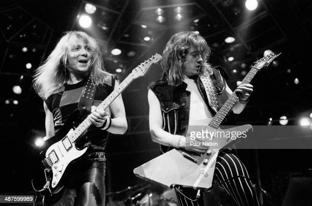 British musicians Dave Murray and Adrian Smith guitarists for the band Iron Maiden perform onstage at Madison Square Garden New York New York October...