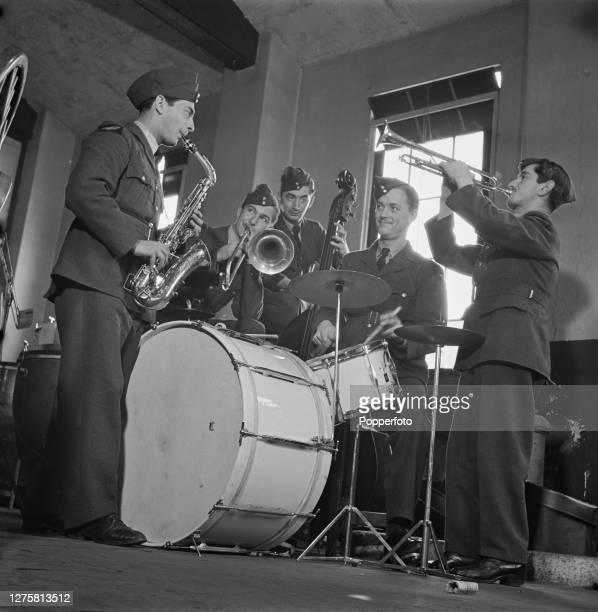 British musicians from left saxophonist Harry Lewis trombonist Eric Breeze bassist Arthur Maden drummer Jock Cummings and trumpeter Archie Craig...