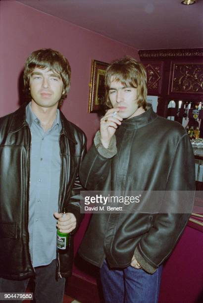 British musicians Liam and Noel Gallagher of rock group Oasis at the Lyceum Theatre for Steve Coogan's show 'The man who thinks he's it' opening...