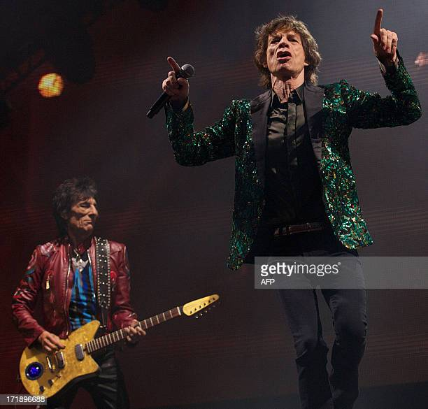 British musicians Mick Jagger and Ron Wood of the Rolling Stones perform on the Pyramid Stage on the fourth day of the Glastonbury Festival of...