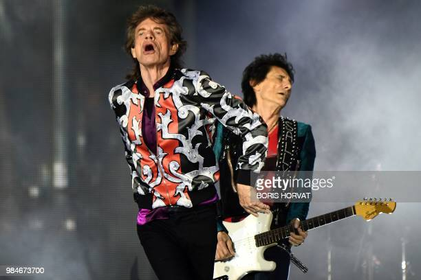 British musicians Mick Jagger and Ronnie Wood of The Rolling Stones perform a concert at The Velodrome Stadium in Marseille on June 26 as part of...