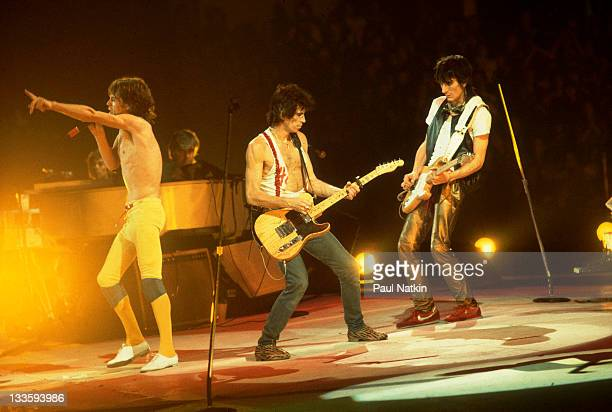 British musicians Mick Jagger Keith Richards and Ronnie Wood of the band The Rolling Stones perform on stage during a North American tour 1981