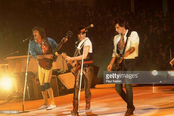British musicians Mick Jagger Ronnie Wood and Keith Richards of the band The Rolling Stones perform on stage during a North American tour 1981