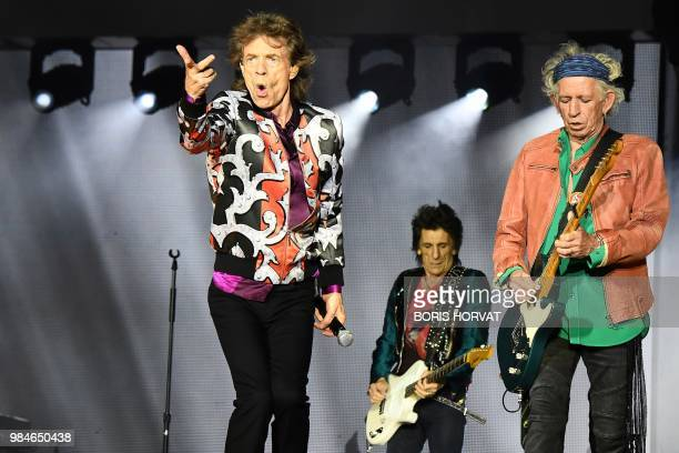 British musicians Mick Jagger Ronnie Wood and Keith Richards of The Rolling Stones perform a concert at The Velodrome Stadium in Marseille on June 26...