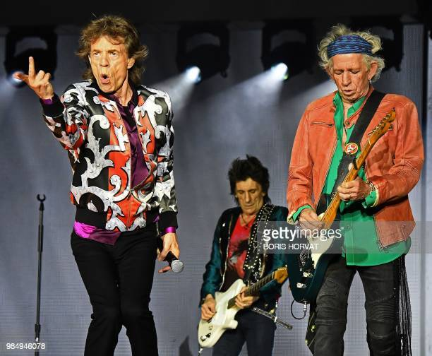 British musicians Mick Jagger Ronnie Wood and Keith Richards of The Rolling Stones perform during a concert at The Velodrome Stadium in Marseille on...