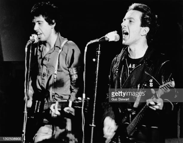 British musicians Mick Jones and Joe Strummer of punk rock band The Clash performing live, circa 1978.
