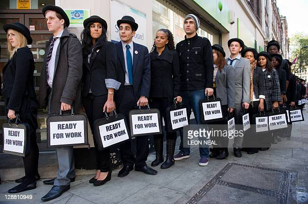 British musicians Miss Dynamite and Charlie Simpson join unemployed young people as they stand in line outside a job centre in central London during...